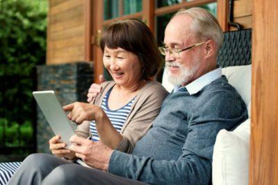 Seniors looking at tablet